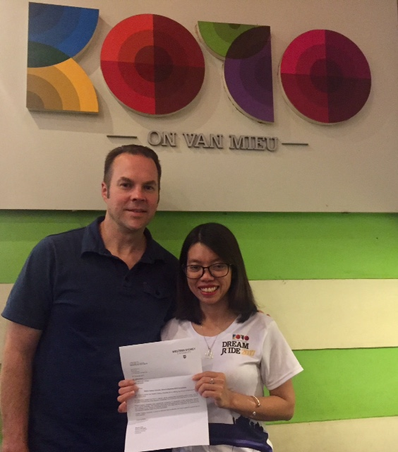 Drtimmyhall presenting university scholarship to KOTO in Vietnam